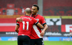SOUTHAMPTON, ENGLAND - DECEMBER 13: Nathan Redmond(L) and Ryan Bertrand of Southampton during the Premier League match between Southampton and Sheffield United at St Mary's Stadium on December 13, 2020 in Southampton, England. A limited number of spectators (2000) are welcomed back to stadiums to watch elite football across England. This was following easing of restrictions on spectators in tiers one and two areas only. (Photo by Matt Watson/Southampton FC via Getty Images)