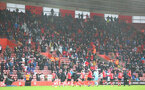 SOUTHAMPTON, ENGLAND - DECEMBER 13: Southampton players acknowledge fans during the Premier League match between Southampton and Sheffield United at St Mary's Stadium on December 13, 2020 in Southampton, England. A limited number of spectators (2000) are welcomed back to stadiums to watch elite football across England. This was following easing of restrictions on spectators in tiers one and two areas only. (Photo by Matt Watson/Southampton FC via Getty Images)