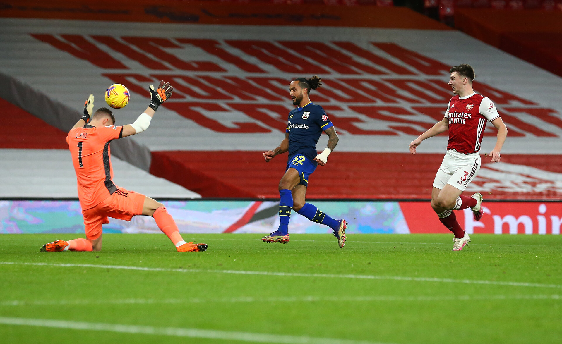 LONDON, ENGLAND - DECEMBER 16: Theo Walcott of Southampton opens the scoring during the Premier League match between Arsenal and Southampton at Emirates Stadium on December 16, 2020 in London, England. The match will be played without fans, behind closed doors as a Covid-19 precaution. (Photo by Matt Watson/Southampton FC via Getty Images)