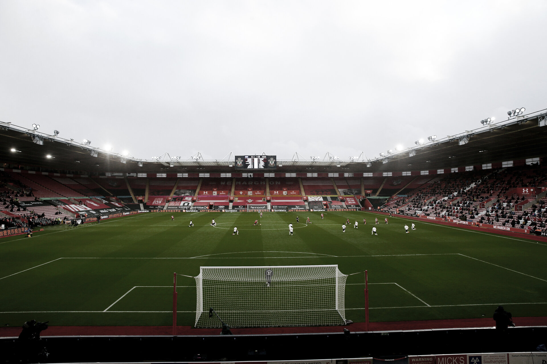 SOUTHAMPTON, ENGLAND - DECEMBER 19: Players take a knee in support of an anti-racism message during the Premier League match between Southampton and Manchester City at St Mary's Stadium on December 19, 2020 in Southampton, England. A limited number of fans (2000) are welcomed back to stadiums to watch elite football across England. This was following easing of restrictions on spectators in tiers one and two areas only. (Photo by Matt Watson/Southampton FC via Getty Images)
