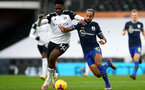 LONDON, ENGLAND - DECEMBER 26: Ola Aina (L) of Fulham and Theo Walcott (R) of Southampton during the Premier League match between Fulham and Southampton at Craven Cottage on December 26, 2020 in London, England. The match will be played without fans, behind closed doors as a Covid-19 precaution. (Photo by Matt Watson/Southampton FC via Getty Images)