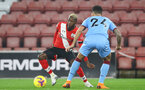 SOUTHAMPTON, ENGLAND - DECEMBER 29: Moussa Djenepo of Southampton during the Premier League match between Southampton and West Ham United at St Mary's Stadium on December 29, 2020 in Southampton, England. The match will be played without fans, behind closed doors as a Covid-19 precaution. (Photo by Matt Watson/Southampton FC via Getty Images)