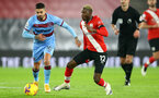 SOUTHAMPTON, ENGLAND - DECEMBER 29: Manuel Lanzini(L) West Ham and Moussa Djenepo (R) of Southampton during the Premier League match between Southampton and West Ham United at St Mary's Stadium on December 29, 2020 in Southampton, England. The match will be played without fans, behind closed doors as a Covid-19 precaution. (Photo by Matt Watson/Southampton FC via Getty Images)