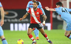 SOUTHAMPTON, ENGLAND - DECEMBER 29: Theo Walcott of Southampton during the Premier League match between Southampton and West Ham United at St Mary's Stadium on December 29, 2020 in Southampton, England. The match will be played without fans, behind closed doors as a Covid-19 precaution. (Photo by Matt Watson/Southampton FC via Getty Images)