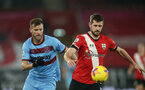 SOUTHAMPTON, ENGLAND - DECEMBER 29: Andriy Yarmolenko (L) of West Ham Jack Stephens (R) of Southampton during the Premier League match between Southampton and West Ham United at St Mary's Stadium on December 29, 2020 in Southampton, England. The match will be played without fans, behind closed doors as a Covid-19 precaution. (Photo by Matt Watson/Southampton FC via Getty Images)