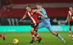 SOUTHAMPTON, ENGLAND - DECEMBER 29: James Ward-Prowse(L) of Southampton and Tomas Soucek (R) of West Ham during the Premier League match between Southampton and West Ham United at St Mary's Stadium on December 29, 2020 in Southampton, England. The match will be played without fans, behind closed doors as a Covid-19 precaution. (Photo by Matt Watson/Southampton FC via Getty Images)