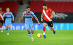 SOUTHAMPTON, ENGLAND - DECEMBER 29: Shane Long(R) of Southampton and Manuel Lanzini(L) of West Ham during the Premier League match between Southampton and West Ham United at St Mary's Stadium on December 29, 2020 in Southampton, England. (Photo by Matt Watson/Southampton FC via Getty Images)