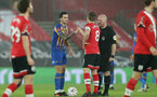 SOUTHAMPTON, ENGLAND - JANUARY 19: Ollie Norburn(L) of Shrewsbury and James Ward-Prowse (R) of Southampton during the FA Cup Third Round match between Southampton and Shrewsbury Town on January 19, 2021 in Southampton, England. Sporting stadiums around the UK remain under strict restrictions due to the Coronavirus Pandemic as Government social distancing laws prohibit fans inside venues resulting in games being played behind closed doors. (Photo by Chris Moorhouse/Southampton FC via Getty Images)