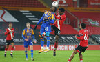 SOUTHAMPTON, ENGLAND - JANUARY 19: Shilow Tracey (L) of Shrewsbury and Kgaogelo Chauke (R) of Southampton  during the FA Cup Third Round match between Southampton and Shrewsbury Town on January 19, 2021 in Southampton, England. Sporting stadiums around the UK remain under strict restrictions due to the Coronavirus Pandemic as Government social distancing laws prohibit fans inside venues resulting in games being played behind closed doors. (Photo by Matt Watson/Southampton FC via Getty Images)