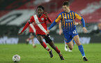 SOUTHAMPTON, ENGLAND - JANUARY 19: Kgaogelo Chauke (L) of Southampton and Ryan Sears (R) of Shrewsbury during the FA Cup Third Round match between Southampton and Shrewsbury Town on January 19, 2021 in Southampton, England. Sporting stadiums around the UK remain under strict restrictions due to the Coronavirus Pandemic as Government social distancing laws prohibit fans inside venues resulting in games being played behind closed doors. (Photo by Matt Watson/Southampton FC via Getty Images)