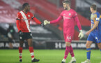 SOUTHAMPTON, ENGLAND - JANUARY 19: Dan N'Lundulu(L) of and Fraser Forster (R) of Southampton during the FA Cup Third Round match between Southampton and Shrewsbury Town on January 19, 2021 in Southampton, England. Sporting stadiums around the UK remain under strict restrictions due to the Coronavirus Pandemic as Government social distancing laws prohibit fans inside venues resulting in games being played behind closed doors. (Photo by Matt Watson/Southampton FC via Getty Images)
