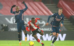 SOUTHAMPTON, ENGLAND - JANUARY 26: Alexandre Lacazette (L) of Arsenal, Ibrahima Diallo (center) of Southampton and Rob Holding (R) of Arsenal during the Premier League match between Southampton and Arsenal at St Mary's Stadium on January 26, 2021 in Southampton, England. Sporting stadiums around the UK remain under strict restrictions due to the Coronavirus Pandemic as Government social distancing laws prohibit fans inside venues resulting in games being played behind closed doors. (Photo by Matt Watson/Southampton FC via Getty Images)