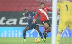 SOUTHAMPTON, ENGLAND - JANUARY 26: Nicolas Pepe (L) of Arsenal and Yan Valery(R) of Southampton during the Premier League match between Southampton and Arsenal at St Mary's Stadium on January 26, 2021 in Southampton, England. Sporting stadiums around the UK remain under strict restrictions due to the Coronavirus Pandemic as Government social distancing laws prohibit fans inside venues resulting in games being played behind closed doors. (Photo by Chris Moorhouse/Southampton FC via Getty Images)