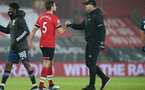 SOUTHAMPTON, ENGLAND - JANUARY 26: Jack Stephens (L) of and Ralph Hasenhuttl (R) during the Premier League match between Southampton and Arsenal at St Mary's Stadium on January 26, 2021 in Southampton, England. Sporting stadiums around the UK remain under strict restrictions due to the Coronavirus Pandemic as Government social distancing laws prohibit fans inside venues resulting in games being played behind closed doors. (Photo by Chris Moorhouse/Southampton FC via Getty Images)