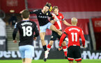 SOUTHAMPTON, ENGLAND - JANUARY 30: Jack Grealish (L) of Aston Villa and James Ward-Prowse(R) of Southampton during the Premier League match between Southampton and Aston Villa at St Mary's Stadium on January 30, 2021 in Southampton, England. Sporting stadiums around the UK remain under strict restrictions due to the Coronavirus Pandemic as Government social distancing laws prohibit fans inside venues resulting in games being played behind closed doors. (Photo by Matt Watson/Southampton FC via Getty Images)