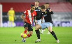 SOUTHAMPTON, ENGLAND - JANUARY 30: Theo Walcott (L) of Southampton and Matt Targett (R) of Aston Villa during the Premier League match between Southampton and Aston Villa at St Mary's Stadium on January 30, 2021 in Southampton, England. Sporting stadiums around the UK remain under strict restrictions due to the Coronavirus Pandemic as Government social distancing laws prohibit fans inside venues resulting in games being played behind closed doors. (Photo by Matt Watson/Southampton FC via Getty Images)
