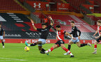 SOUTHAMPTON, ENGLAND - JANUARY 30: Tyrone Mings(L) of Aston Villa and Ché Adams (R) of Southampton during the Premier League match between Southampton and Aston Villa at St Mary's Stadium on January 30, 2021 in Southampton, England. Sporting stadiums around the UK remain under strict restrictions due to the Coronavirus Pandemic as Government social distancing laws prohibit fans inside venues resulting in games being played behind closed doors. (Photo by Matt Watson/Southampton FC via Getty Images)