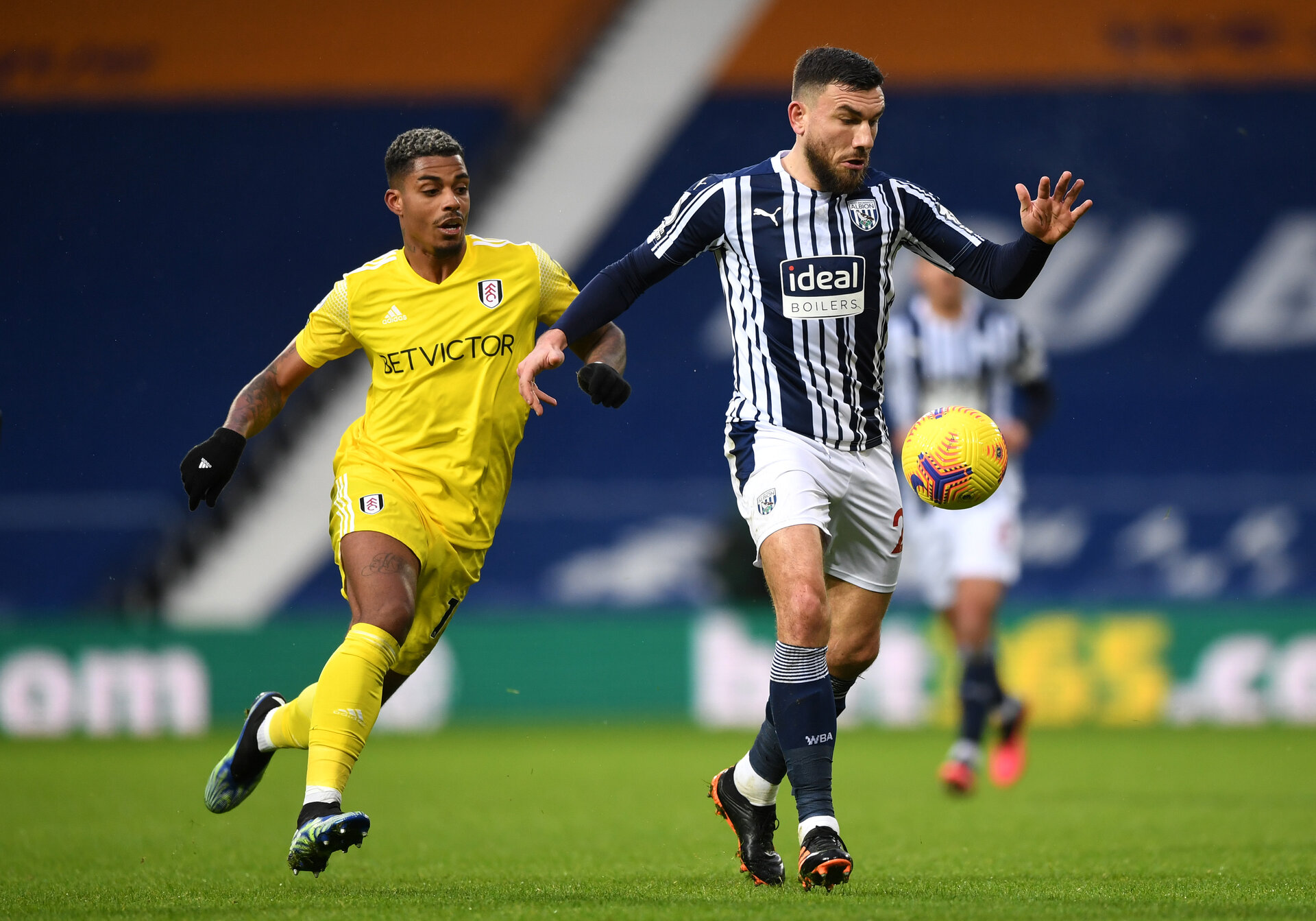 WEST BROMWICH, ENGLAND - JANUARY 30:  Robert Snodgrass of West Bromwich Albion is challenged by Mario Lemina of Fulham during the Premier League match between West Bromwich Albion and Fulham at The Hawthorns on January 30, 2021 in West Bromwich, England. Sporting stadiums around the UK remain under strict restrictions due to the Coronavirus Pandemic as Government social distancing laws prohibit fans inside venues resulting in games being played behind closed doors. (Photo by Gareth Copley/Getty Images)