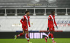NEWCASTLE UPON TYNE, ENGLAND - FEBRUARY 06: Ché Adams(L) and Dan N'Lundulu (R) of Southampton during the Premier League match between Newcastle United and Southampton at St. James Park on February 06, 2021 in Newcastle upon Tyne, England. Sporting stadiums around the UK remain under strict restrictions due to the Coronavirus Pandemic as Government social distancing laws prohibit fans inside venues resulting in games being played behind closed doors. (Photo by Matt Watson/Southampton FC via Getty Images)