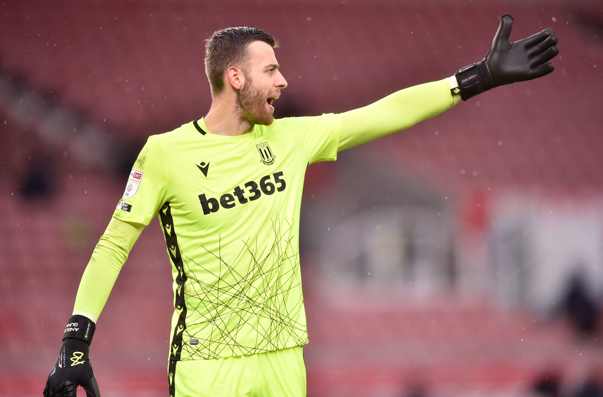 STOKE ON TRENT, ENGLAND - FEBRUARY 06: Angus Gunn of Stoke City gestures during the Sky Bet Championship match between Stoke City and Reading at Bet365 Stadium on February 06, 2021 in Stoke on Trent, England. Sporting stadiums around the UK remain under strict restrictions due to the Coronavirus Pandemic as Government social distancing laws prohibit fans inside venues resulting in games being played behind closed doors. (Photo by Nathan Stirk/Getty Images)
