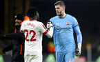 WOLVERHAMPTON, ENGLAND - FEBRUARY 11: Mohammed Salisu(L) and Fraser Forster of Southampton during The Emirates FA Cup Fifth Round match between Wolverhampton Wanderers and Southampton at Molineux on February 11, 2021 in Wolverhampton, England. Sporting stadiums around the UK remain under strict restrictions due to the Coronavirus Pandemic as Government social distancing laws prohibit fans inside venues resulting in games being played behind closed doors. (Photo by Matt Watson/Southampton FC via Getty Images)