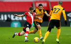 SOUTHAMPTON, ENGLAND - FEBRUARY 14: Stuart Armstrong(L) of Southampton and Ruben Neves (R) of Wolves during the Premier League match between Southampton and Wolverhampton Wanderers at St Mary's Stadium on February 14, 2021 in Southampton, England. Sporting stadiums around the UK remain under strict restrictions due to the Coronavirus Pandemic as Government social distancing laws prohibit fans inside venues resulting in games being played behind closed doors. (Photo by Matt Watson/Southampton FC via Getty Images)
