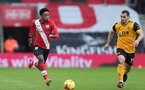 SOUTHAMPTON, ENGLAND - FEBRUARY 14: Kyle Walker-Peters (L) of Southampton and Jonny (R) of Wolves during the Premier League match between Southampton and Wolverhampton Wanderers at St Mary's Stadium on February 14, 2021 in Southampton, England. Sporting stadiums around the UK remain under strict restrictions due to the Coronavirus Pandemic as Government social distancing laws prohibit fans inside venues resulting in games being played behind closed doors. (Photo by Matt Watson/Southampton FC via Getty Images)