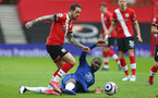 SOUTHAMPTON, ENGLAND - FEBRUARY 20: Danny Ings (L) of Southampton and Antonio Rudiger (R) of Chelsea during the Premier League match between Southampton and Chelsea at St Mary's Stadium on February 20, 2021 in Southampton, England. Sporting stadiums around the UK remain under strict restrictions due to the Coronavirus Pandemic as Government social distancing laws prohibit fans inside venues resulting in games being played behind closed doors. (Photo by Matt Watson/Southampton FC via Getty Images)