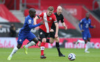 SOUTHAMPTON, ENGLAND - FEBRUARY 20: N'Golo Kante (L) of Chelsea and James Ward-Prowse (R) of Southampton  during the Premier League match between Southampton and Chelsea at St Mary's Stadium on February 20, 2021 in Southampton, England. Sporting stadiums around the UK remain under strict restrictions due to the Coronavirus Pandemic as Government social distancing laws prohibit fans inside venues resulting in games being played behind closed doors. (Photo by Matt Watson/Southampton FC via Getty Images)