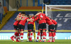 LEEDS, ENGLAND - FEBRUARY 23: Southampton players huddle ahead of the Premier League match between Leeds United and Southampton at Elland Road on February 23, 2021 in Leeds, England. Sporting stadiums around the UK remain under strict restrictions due to the Coronavirus Pandemic as Government social distancing laws prohibit fans inside venues resulting in games being played behind closed doors. (Photo by Matt Watson/Southampton FC via Getty Images)