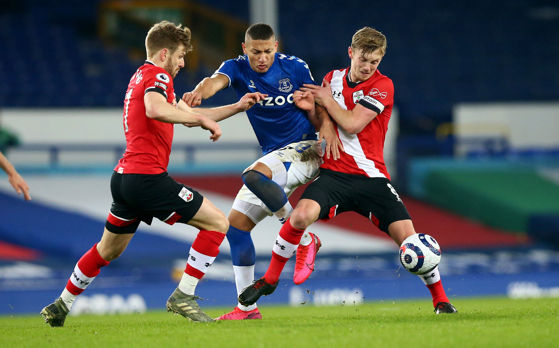 LIVERPOOL, ENGLAND - MARCH 01: Stuart Armstrong(L) and James Ward-Prowse(R) of Southampton double up on Richarlison of Everton during the Premier League match between Everton and Southampton at Goodison Park on March 01, 2021 in Liverpool, England. Sporting stadiums around the UK remain under strict restrictions due to the Coronavirus Pandemic as Government social distancing laws prohibit fans inside venues resulting in games being played behind closed doors. (Photo by Matt Watson/Southampton FC via Getty Images)
