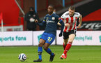 SHEFFIELD, ENGLAND - MARCH 06: Ibrahima Diallo (L) of Southampton and John Lundstram (R) of Sheffield during the Premier League match between Sheffield United and Southampton at Bramall Lane on March 06, 2021 in Sheffield, England. (Photo by Matt Watson/SouthamptonFC)