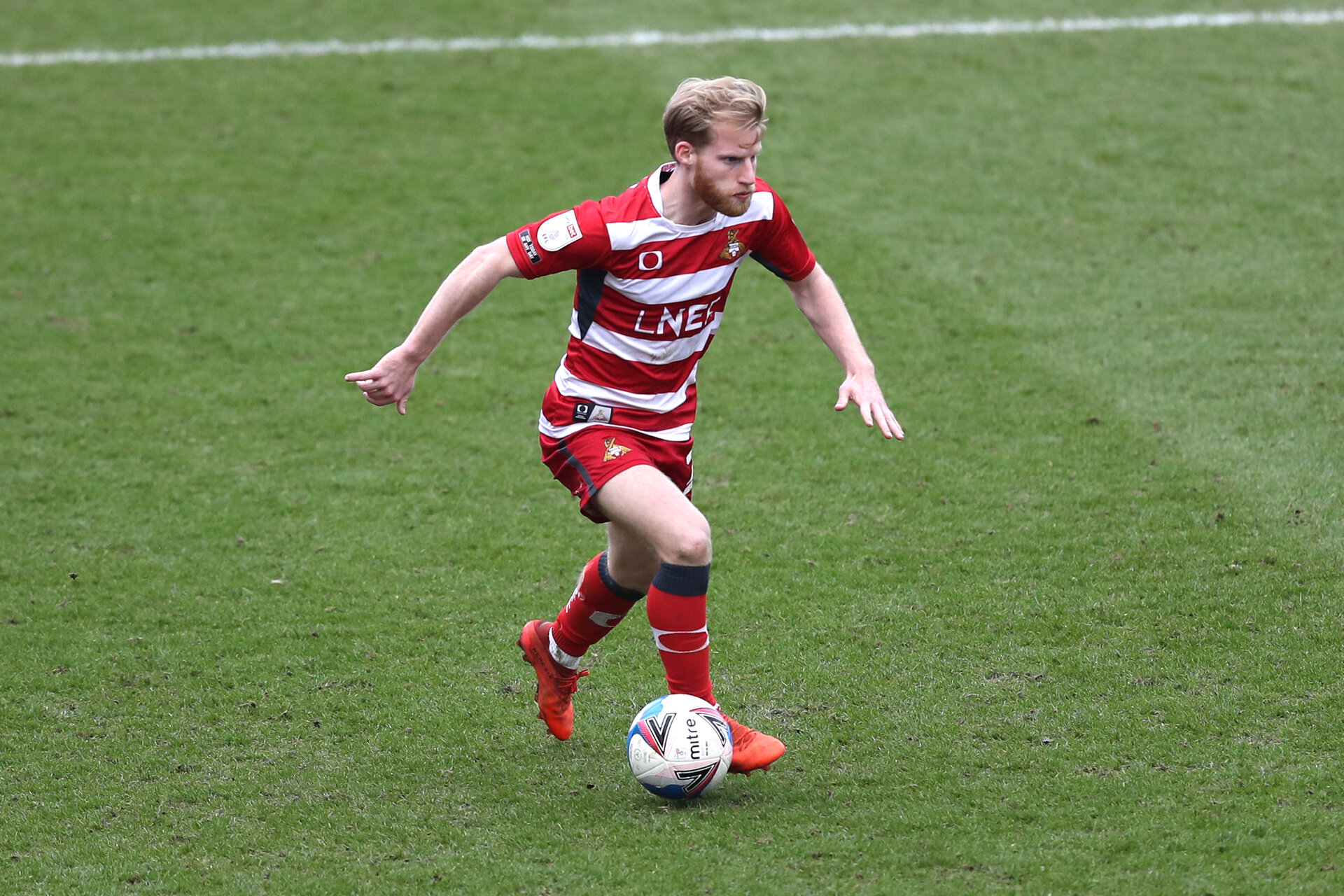 DONCASTER, ENGLAND - MARCH 06: Josh Sims of Doncaster Rovers runs with the ball during the Sky Bet League One match between Doncaster Rovers and Plymouth Argyle at Keepmoat Stadium on March 06, 2021 in Doncaster, England. Sporting stadiums around the UK remain under strict restrictions due to the Coronavirus Pandemic as Government social distancing laws prohibit fans inside venues resulting in games being played behind closed doors. (Photo by George Wood/Getty Images)