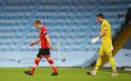 MANCHESTER, ENGLAND - MARCH 10: James Ward-Prowse (L) of Southampton and Alex McCarthy (R) of Southampton walking out ahead of the Premier League match between Manchester City and Southampton at Etihad Stadium on March 10, 2021 in Manchester, England. Sporting stadiums around the UK remain under strict restrictions due to the Coronavirus Pandemic as Government social distancing laws prohibit fans inside venues resulting in games being played behind closed doors. (Photo by Matt Watson/Southampton FC via Getty Images)