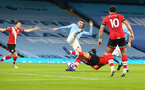 MANCHESTER, ENGLAND - MARCH 10: Jannik Vestergaard of Southampton brought down giving Southampton a penalty during the Premier League match between Manchester City and Southampton at Etihad Stadium on March 10, 2021 in Manchester, England. Sporting stadiums around the UK remain under strict restrictions due to the Coronavirus Pandemic as Government social distancing laws prohibit fans inside venues resulting in games being played behind closed doors. (Photo by Matt Watson/Southampton FC via Getty Images)