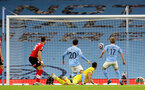 MANCHESTER, ENGLAND - MARCH 10: Alex McCarthy of Southampton unable to stop Kevin De Bruyne from scoring  during the Premier League match between Manchester City and Southampton at Etihad Stadium on March 10, 2021 in Manchester, England. Sporting stadiums around the UK remain under strict restrictions due to the Coronavirus Pandemic as Government social distancing laws prohibit fans inside venues resulting in games being played behind closed doors. (Photo by Matt Watson/Southampton FC via Getty Images)