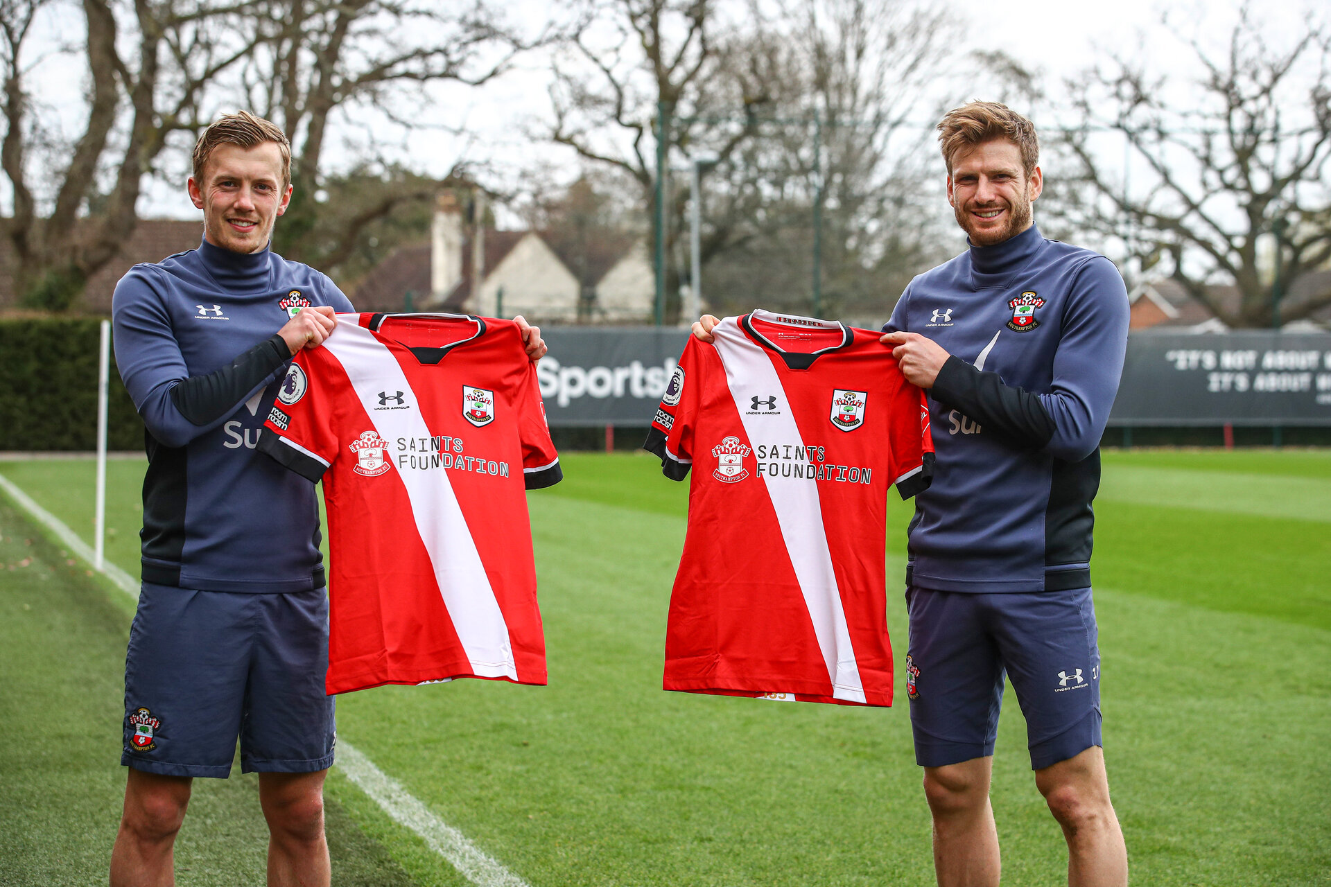 SOUTHAMPTON, ENGLAND - MARCH 18: James Ward-Prowse(L) and Stuart Armstrong hold a shirt that will feature Saints Foundation branding on the front of the shirt for the upcoming fixture against Burnley, pictured at the Staplewood Campus on March 18, 2021 in Southampton, England. (Photo by Matt Watson/Southampton FC via Getty Images)