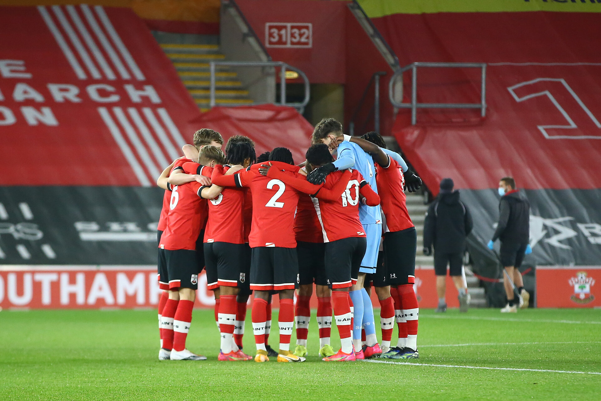 SOUTHAMPTON, ENGLAND - MARCH 23: Southampton players huddle ahead of the FA Youth Cup fourth round match between Southampton and Burton Albion at St Mary's Stadium on March 23, 2021 in Southampton, England. (Photo by Isabelle Field/Southampton FC via Getty Images)