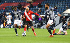WEST BROMWICH, ENGLAND - APRIL 12: Nathan Redmond(centre) of Southampton under pressure from Ainsley Maitland-Niles(L) and Kyle  Bartley(R) of West Brom during the Premier League match between West Bromwich Albion and Southampton at The Hawthorns on April 12, 2021 in West Bromwich, England. Sporting stadiums around the UK remain under strict restrictions due to the Coronavirus Pandemic as Government social distancing laws prohibit fans inside venues resulting in games being played behind closed doors. (Photo by Matt Watson/Southampton FC via Getty Images)