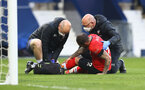 WEST BROMWICH, ENGLAND - APRIL 12: Danny Ings of receives treatment from club medical staff during the Premier League match between West Bromwich Albion and Southampton at The Hawthorns on April 12, 2021 in West Bromwich, England. Sporting stadiums around the UK remain under strict restrictions due to the Coronavirus Pandemic as Government social distancing laws prohibit fans inside venues resulting in games being played behind closed doors. (Photo by Matt Watson/Southampton FC via Getty Images)