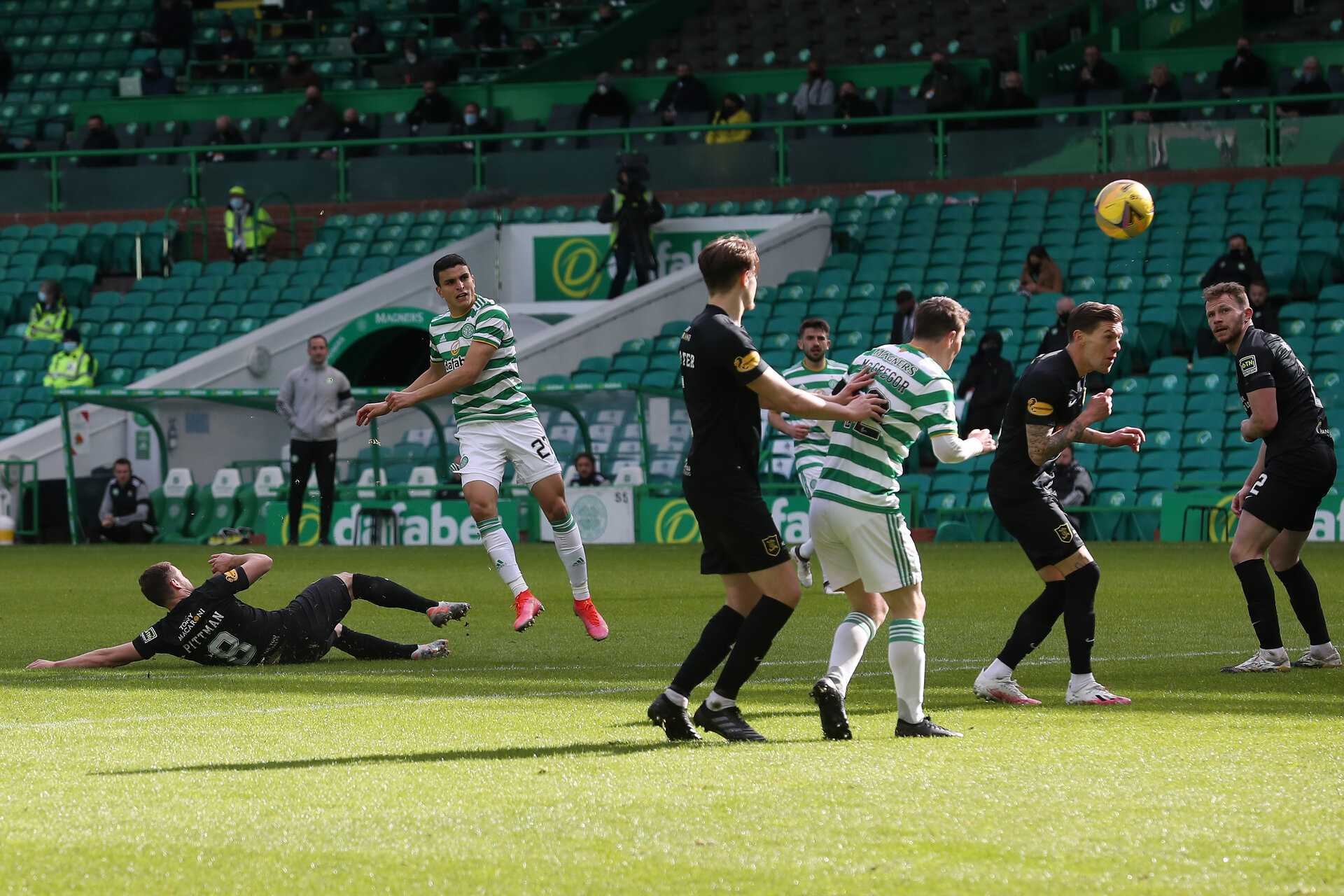 GLASGOW, SCOTLAND - APRIL 10: Mohamed Elyounoussi of Celtic  scores their team's fourth goal  during the Ladbrokes Scottish Premiership match between Celtic and Livingston at Celtic Park on April 10, 2021 in Glasgow, Scotland. Sporting stadiums around the UK remain under strict restrictions due to the Coronavirus Pandemic as Government social distancing laws prohibit fans inside venues resulting in games being played behind closed doors.  (Photo by Ian MacNicol/Getty Images)