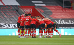 SOUTHAMPTON, ENGLAND - APRIL 30: Saints players huddle during the Premier League match between Southampton and Leicester City at St Mary's Stadium on April 30, 2021 in Southampton, England. Sporting stadiums around the UK remain under strict restrictions due to the Coronavirus Pandemic as Government social distancing laws prohibit fans inside venues resulting in games being played behind closed doors.  (Photo by Matt Watson/Southampton FC via Getty Images)