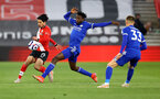 SOUTHAMPTON, ENGLAND - APRIL 30: Takumi Minamino(L) of Southampton and Wilfred Ndidi(R) of Leicester during the Premier League match between Southampton and Leicester City at St Mary's Stadium on April 30, 2021 in Southampton, England. Sporting stadiums around the UK remain under strict restrictions due to the Coronavirus Pandemic as Government social distancing laws prohibit fans inside venues resulting in games being played behind closed doors.  (Photo by Matt Watson/Southampton FC via Getty Images)