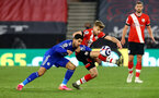 SOUTHAMPTON, ENGLAND - APRIL 30: Ayoze Perez(L) of Leicester and Stuart Armstrong(R) of Southampton during the Premier League match between Southampton and Leicester City at St Mary's Stadium on April 30, 2021 in Southampton, England. Sporting stadiums around the UK remain under strict restrictions due to the Coronavirus Pandemic as Government social distancing laws prohibit fans inside venues resulting in games being played behind closed doors.  (Photo by Matt Watson/Southampton FC via Getty Images)