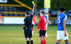 SOUTHPORT, ENGLAND - MAY 07: Sam Bellis of Southampton is shown a yellow card  during the Premier League 2 match between Everton and Southampton B Team at the The Pure Stadium on May 07, 2021 in Southport, England.  (Photo by Isabelle Field/Southampton FC via Getty Images)