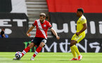 SOUTHAMPTON, ENGLAND - MAY 15: Jack Stephens(L) of Southampton and Ivan Cavaleiro(R) of Fulham during the Premier League match between Southampton and Fulham at St Mary's Stadium on May 15, 2021 in Southampton, England. Sporting stadiums around the UK remain under strict restrictions due to the Coronavirus Pandemic as Government social distancing laws prohibit fans inside venues resulting in games being played behind closed doors.  (Photo by Matt Watson/Southampton FC via Getty Images)