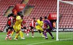 SOUTHAMPTON, ENGLAND - MAY 15: Ché Adams of Southampton scores to open the scoring during the Premier League match between Southampton and Fulham at St Mary's Stadium on May 15, 2021 in Southampton, England. Sporting stadiums around the UK remain under strict restrictions due to the Coronavirus Pandemic as Government social distancing laws prohibit fans inside venues resulting in games being played behind closed doors.  (Photo by Matt Watson/Southampton FC via Getty Images)