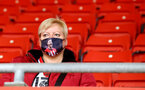 SOUTHAMPTON, ENGLAND - MAY 18: A Southampton fan with a Shane Long face mask during the Premier League match between Southampton and Leeds United at St Mary's Stadium on May 18, 2021 in Southampton, England. (Photo by Isabelle Field/Southampton FC via Getty Images)