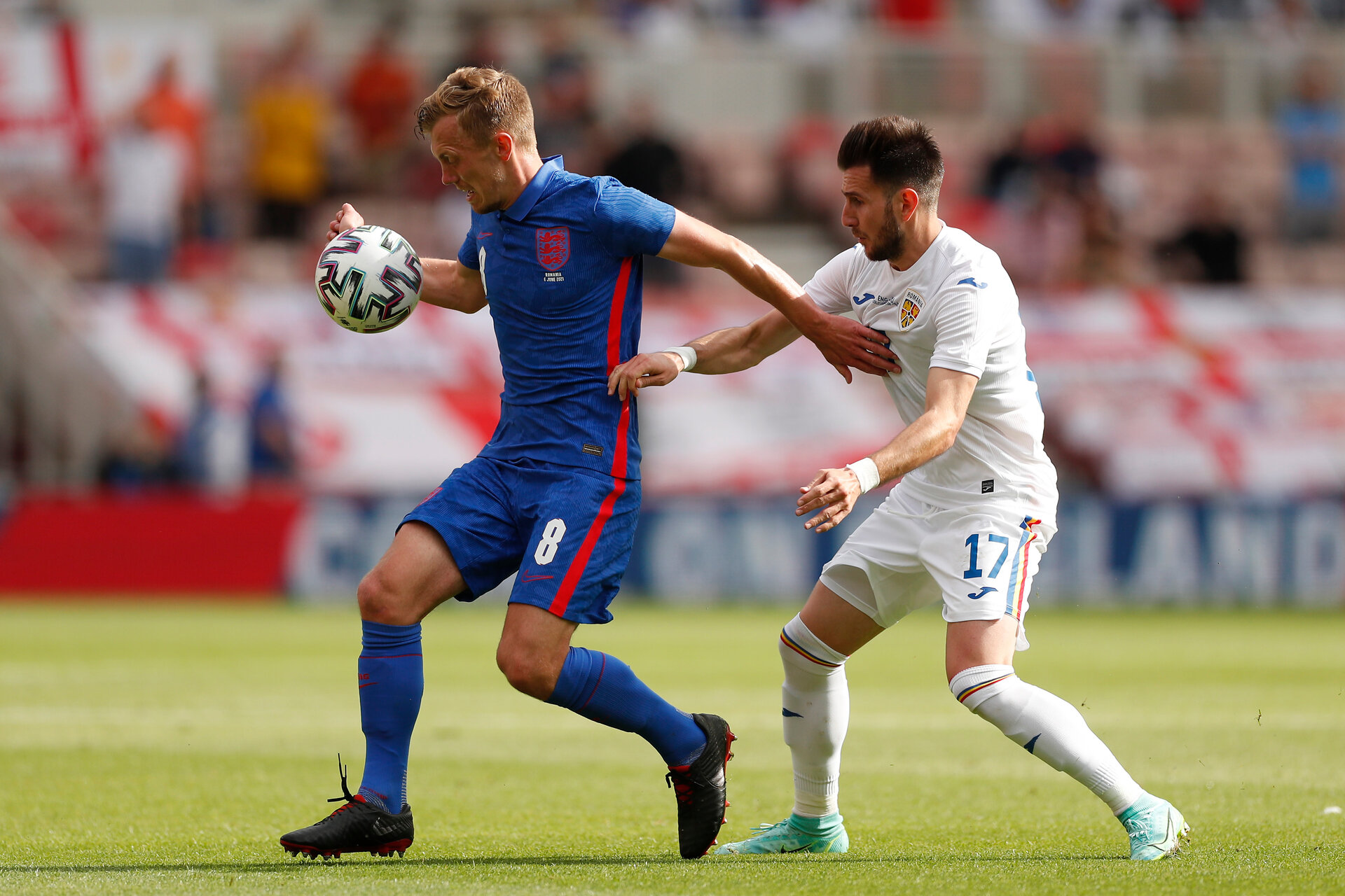 MIDDLESBROUGH, ENGLAND - JUNE 06: James Ward-Prowse of England is closed down by Constantin Paun of Romania during the international friendly match between England and Romania at Riverside Stadium on June 06, 2021 in Middlesbrough, England. (Photo by Lee Smith - Pool/Getty Images)