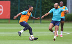 SOUTHAMPTON, ENGLAND - JULY 07: Theo Walcott(L) and Nathan Redmond during a Southampton FC pre-season training session at The Staplewood Campus on July 07, 2021 in Southampton, England. (Photo by Matt Watson/Southampton FC via Getty Images)